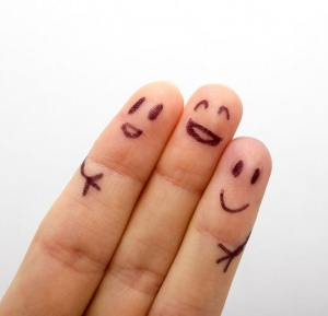 50909920 - three smiling fingers that are very happy to be friends, family concept