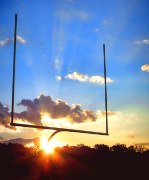 21429809 - american football sport stadium goal posts in end zone over dramatic blue sky during a spectacular sunset
