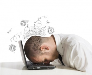 18575374 - concept of stress with businessman sleeping on a laptop